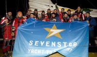 Lithuanian crew of Volvo 60, Ambersail, celebrate completing the Sevenstar Round Britain and Ireland Race. Photo: Paterick Eden